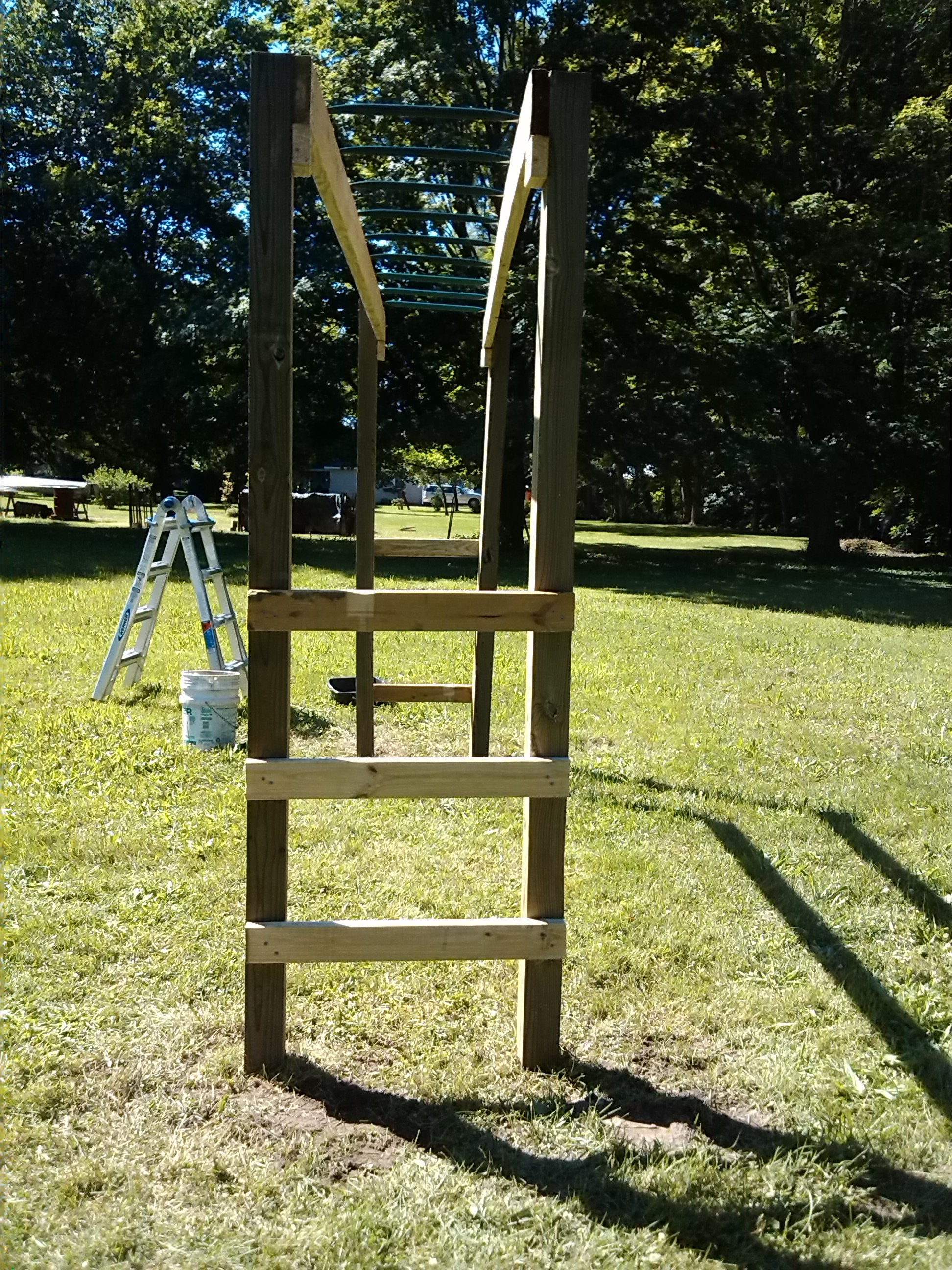 Stand Alone Monkey Bars For Backyard how to build monkey bars: my $100 backyard design -action economics